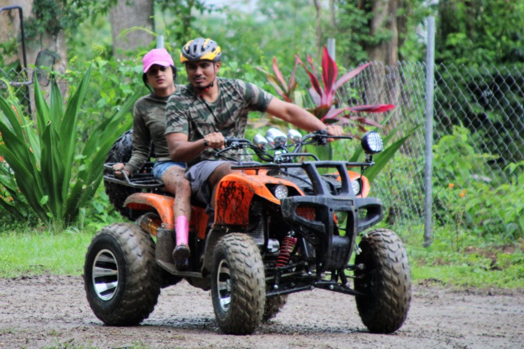 couple rides on an ATV