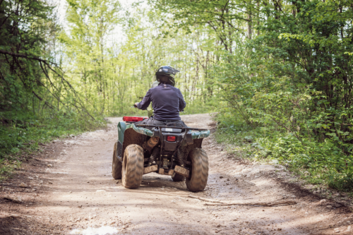 a man riding an atv