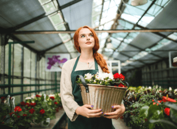 A woman holding a bucket of flowers