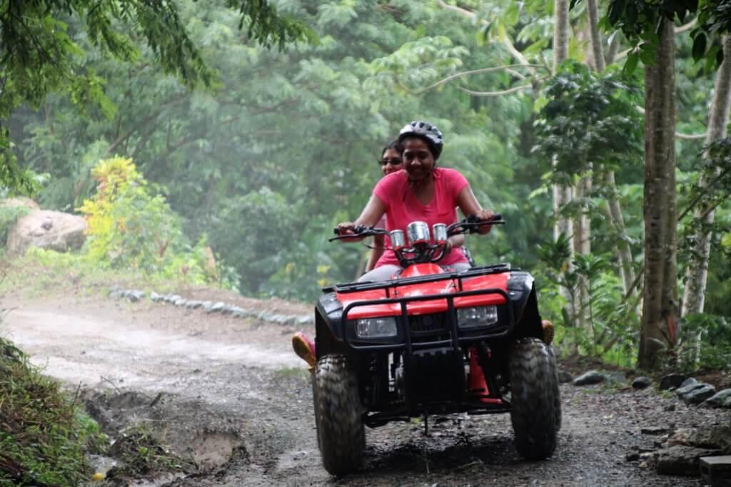women rides an ATV